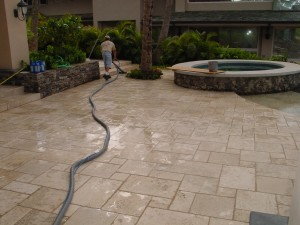 A contractor cleaning Travertine tile